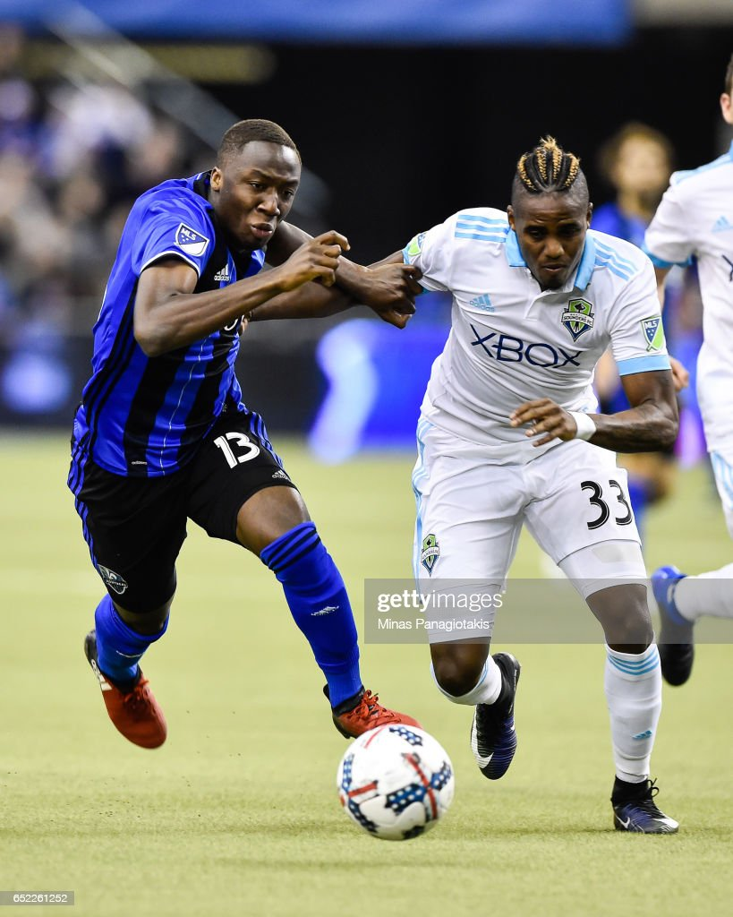 Ballou Tabla #13 of the Montreal Impact and Joevin Jones #33 of the Seattle Sounders chase the ball during the MLS game at Olympic Stadium on March 11, 2017 in Montreal, Quebec, Canada. The Seattle Sounders FC and the Montreal Impact end up in a 2-2 draw.