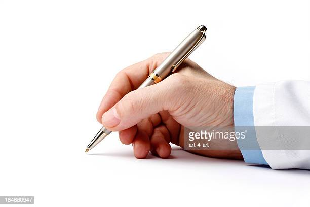 ballpoint pen in the doctor's hand on white background - handwriting stock pictures, royalty-free photos & images