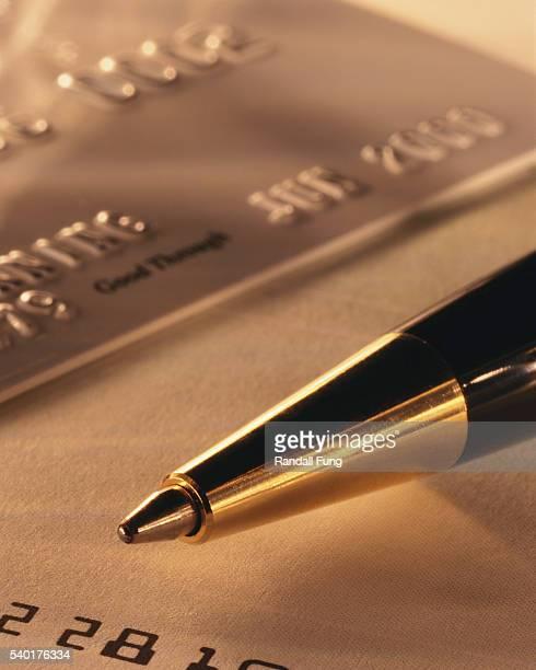 Ballpoint Pen near Credit Card