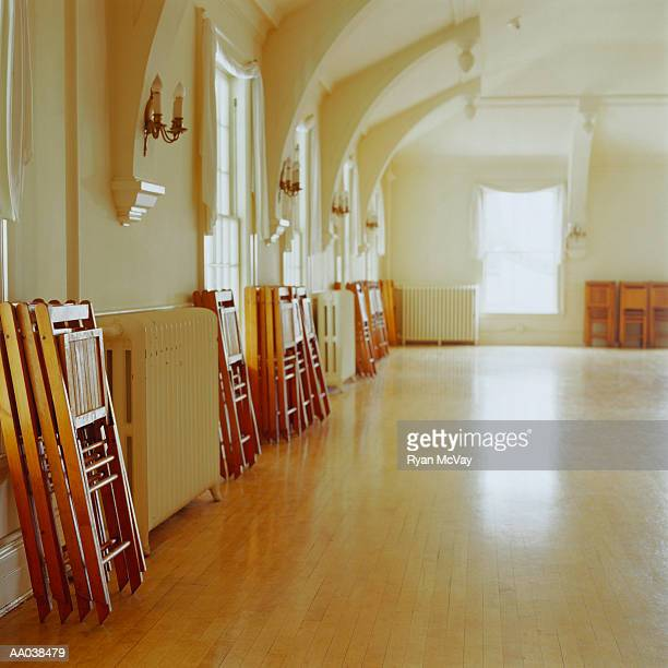 ballroom dance floor with chairs stacked - ballroom stock photos and pictures