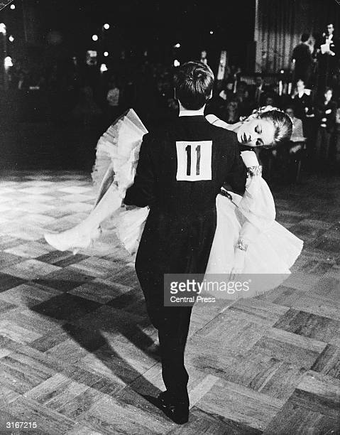A championship winning ballroom dancer is forced to carry off his partner when she collapses from exhaustion after winning the dance title in...