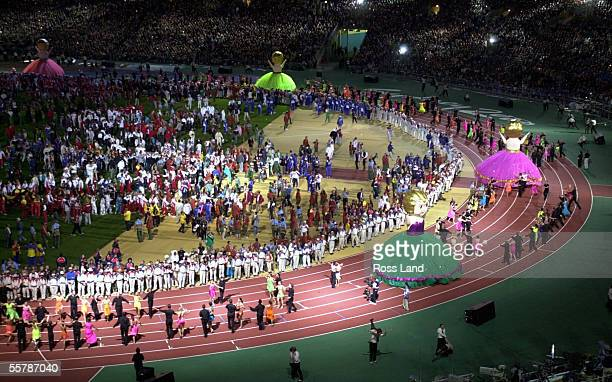 Ballroom dancers do a lap of the athletics track to entertain the crowd during the show at the Sydney Olympic stadium during the closing ceremony for...