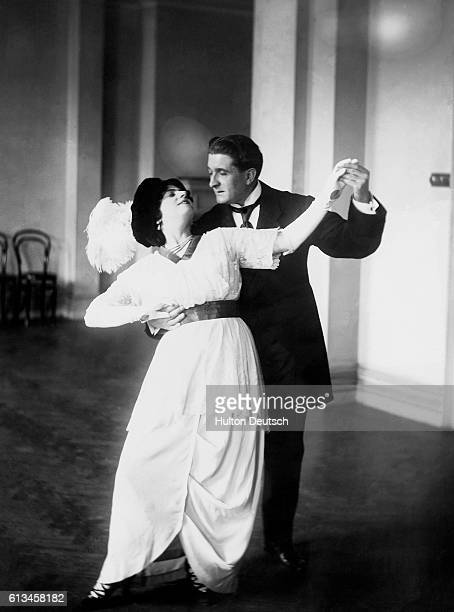 Ballroom dancers Senorita Castora de Guilter and Monsieur Giore perform the Argentine tango at the Comedy Theatre