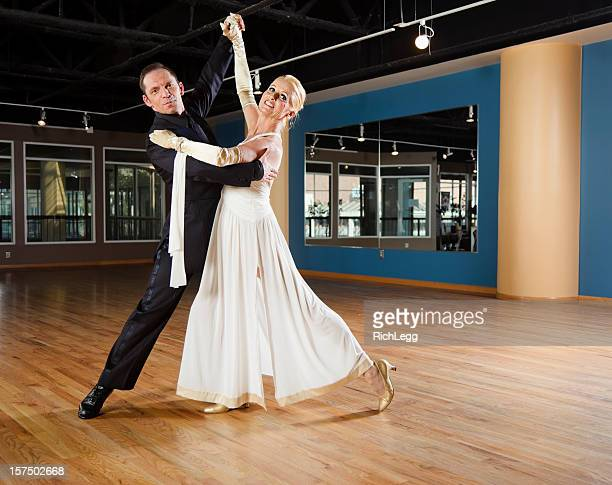 ballroom dancing couple - gewalt stockfoto's en -beelden