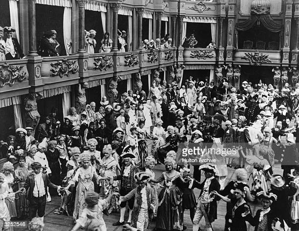 Ballroom scene from the German film 'Madame Dubarry', about the life and times of Louis XV. Titled 'Passion' in the US, the film was directed by...