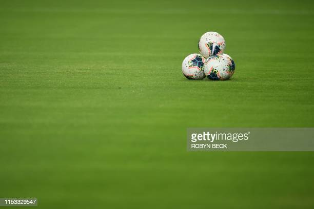 Balls are seen on the pitch ahead of the 2019 Concacaf Gold Cup semifinal football match between Mexico and Haiti on July 2 2019 in Glendale Arizona