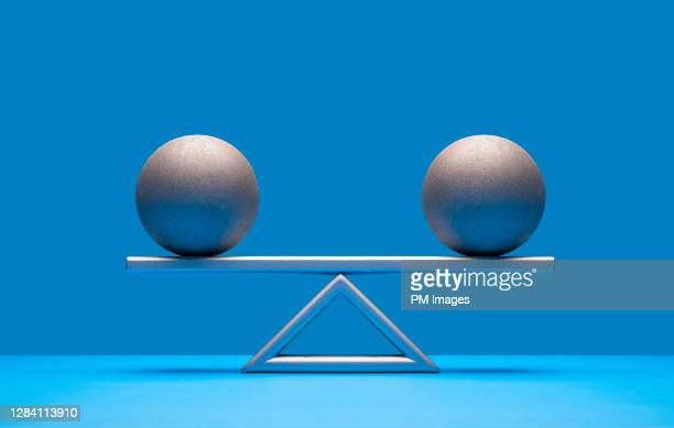 balls balancing on scale - scale stock pictures, royalty-free photos & images