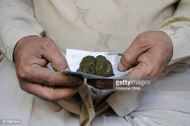 Balls of Bhang being sold at Government approved shops for consumption during Holi celebrations on March 22, 2016 in Mathura, India. Bhang, which is...