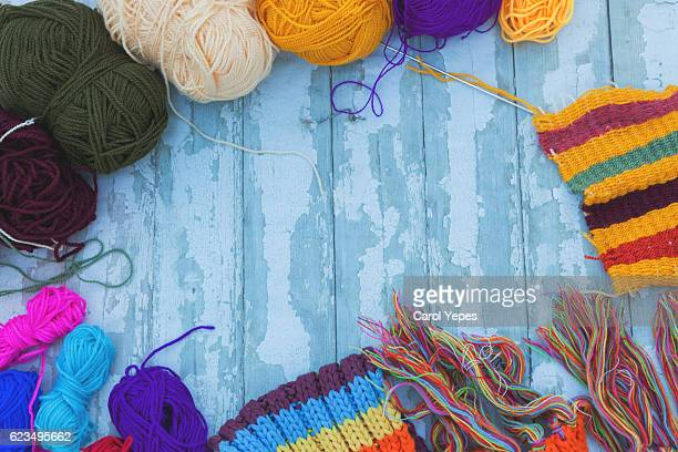 Balls of colored yarn. View from above.  Sample knit. Crochet.B