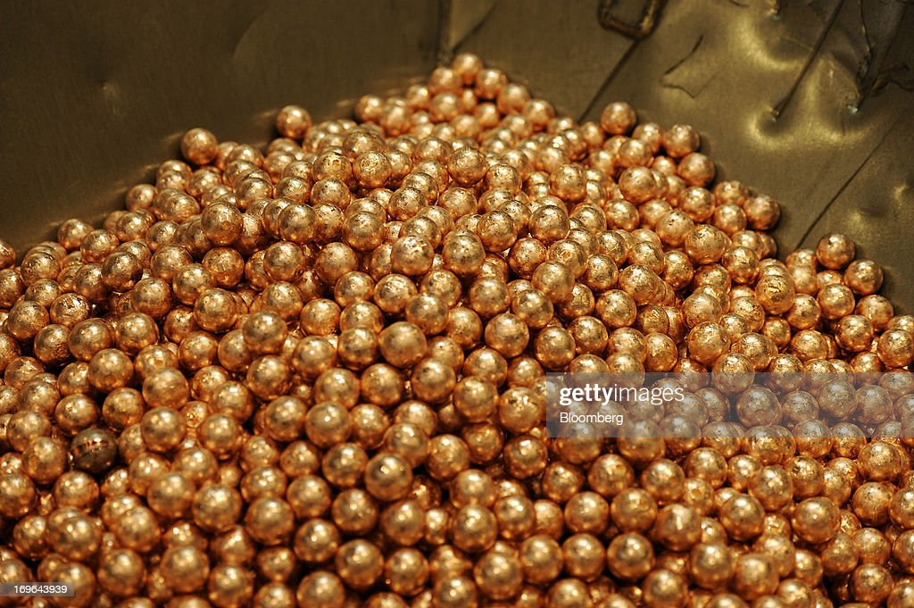 Balls of copper anode sit in a pile at the Luvata Malaysia Bhd. plant in Pasir Gudang, Johor, Malaysia, on Monday, May 13, 2013. At a time when copper stockpiles are rising to the highest in a decade, manufacturers are paying the biggest premiums for the metal in as much as seven years as financing deals lock up supply and extend lines at warehouses. Photographer: Munshi Ahmed/Bloomberg via Getty Images