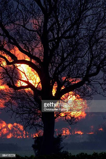Balls of fire continue to erupt as secondary explosions occur at Bruncefield oil depot on December 11 2005 in Hemel Hempstead EnglandThe explosions...