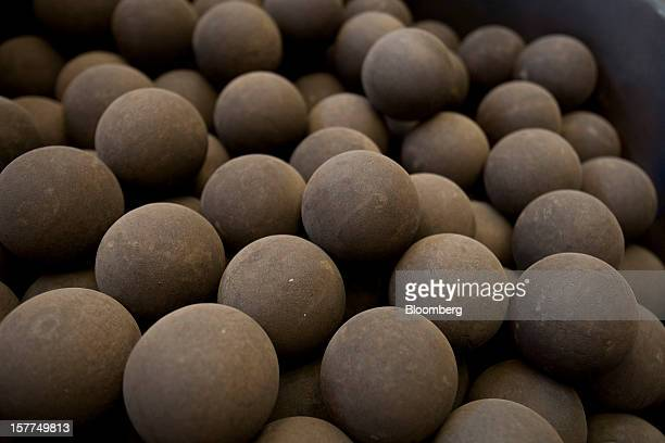 Balls of metal ore sit in a collection drum before loading into a furnace during processing at Katanga Mining Ltd's copper and cobalt mine in Kolwezi...