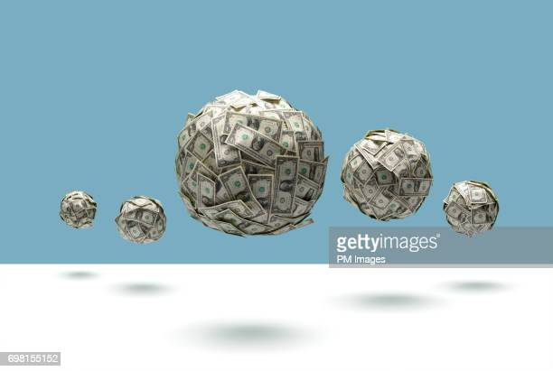Balls of money floating in mid air