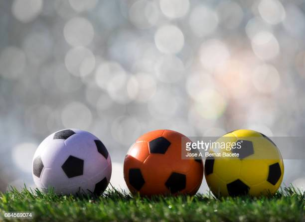 Balls of  soccer ball  on a surface of  grass of a soccer field