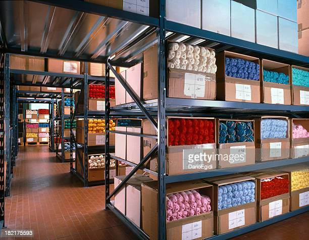 balls of wool arranged on shelves in a textile warehouse - textile industry stock pictures, royalty-free photos & images