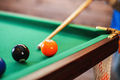 balls on a billiard table in a triangle. men playing billiards