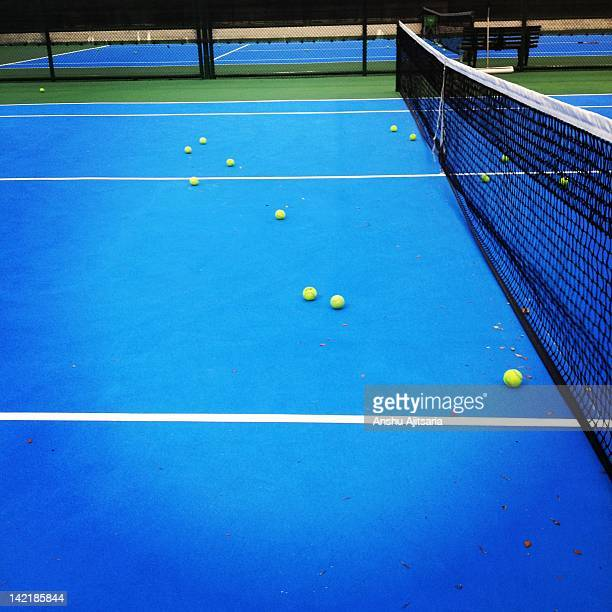 balls on tennis court - hardcourt stock photos and pictures