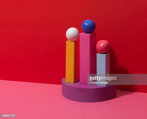 Balls on Top of Coloured Plinths