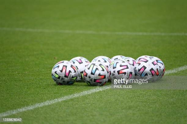 Balls sit on the pitch during England's MD-1 training session at St George's Park in Burton-on-Trent, central England, on July 6, 2021 on the eve of...