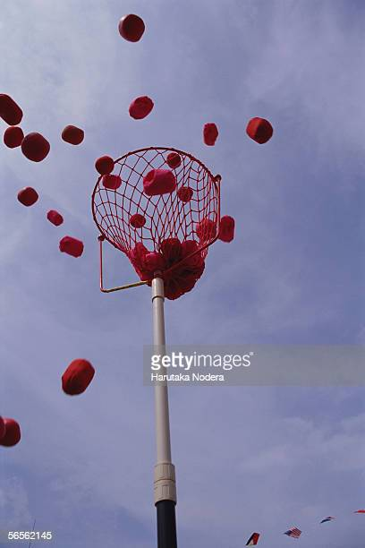 Balls thrown into basket at school sports day