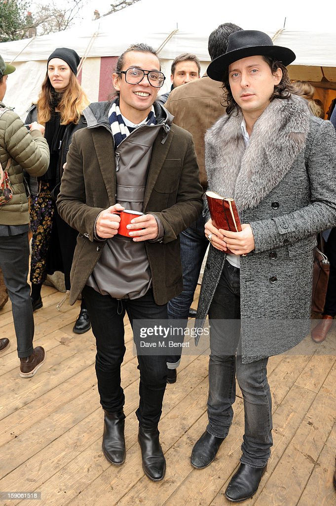 Bally Desinger Michael Herz and Carl Barat attend the 'BALLY Celebrates 60 Years of Conquering Everest' at Bedford Square Gardens on January 7, 2013 in London, England.