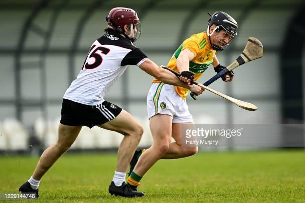 Ballyhaunis , Ireland - 18 October 2020; Ben Murray of Leitrim in action against Andrew Kilcullen of Sligo during the Allianz Hurling League Division...