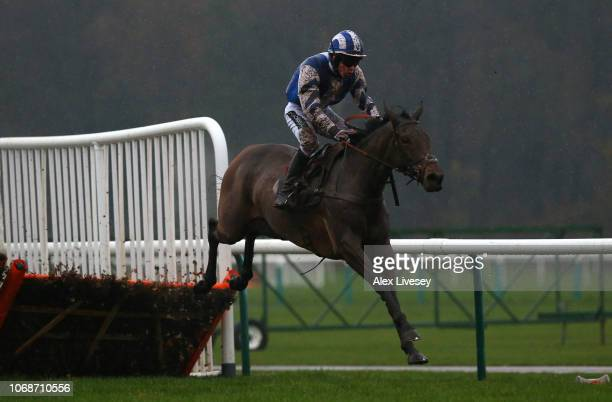 Ballymagoarty Boy ridden by Tom Buckley clears the last fence during their victory in The Watch Racing Uk In Hd Conditional Jockeys' Handicap Hurdle...