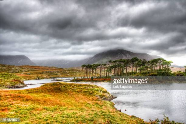 ballynahinch lake under a cloudy sky near connemara national park. - lagarde stock pictures, royalty-free photos & images