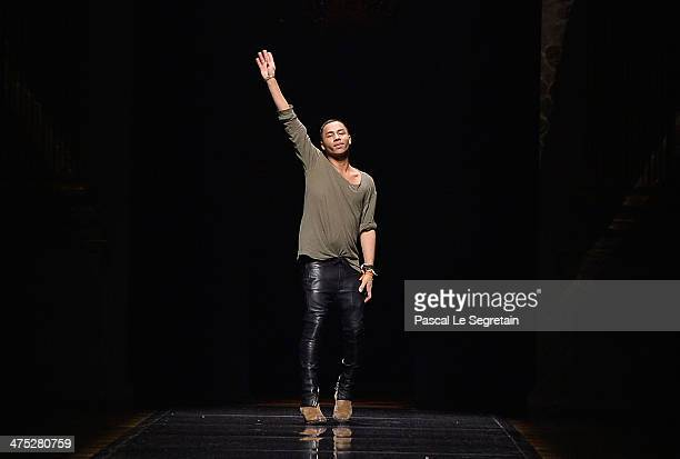 Balmain Fashion designer Olivier Rousteing acknowledges the applause of the public after his show as part of the Paris Fashion Week Womenswear...