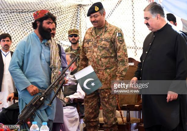 A Baloch militant hands over his gun and surrenders to Baluchistan province Chief Minister Sardar Sanaullah Khan Zehri in Quetta on April 21 2017...
