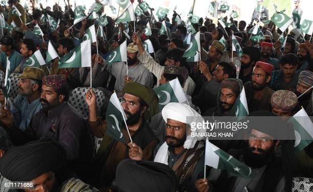 Baloch militants carry Pakistani national flags after they surrenderd to Pakistani security forces in Quetta on April 21 2017 Around 500 Baloch rebel...