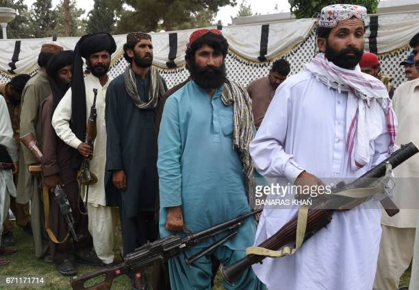 Baloch militants carry their weapons as they prepare to surrender to Pakistani security forces in Quetta on April 21 2017 Around 500 Baloch rebel...