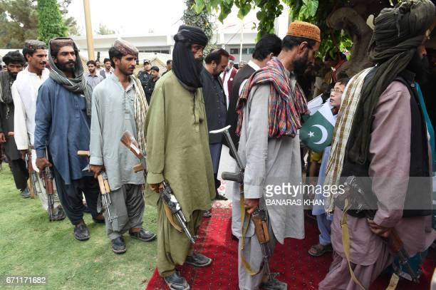 Baloch militants carry their weapons as they surrender to Pakistani security forces in Quetta on April 21 2017 Around 500 Baloch rebel militants on...