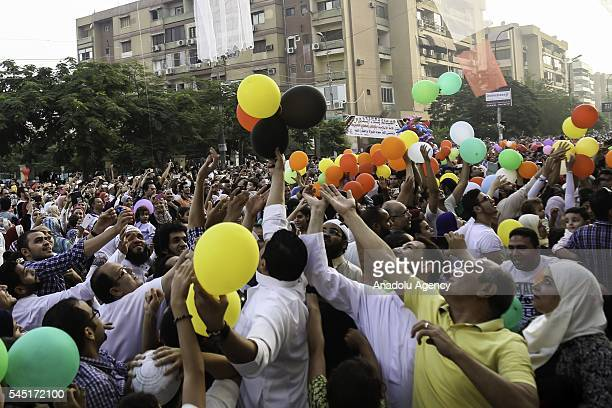 Baloons are presented for children after Muslims perform Eid alFitr prayer during the Eid alFitr holiday at Abu Bakr alSiddiq Mosque in Cairo Egypt...