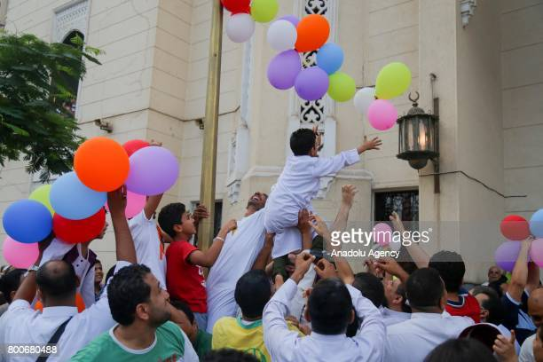 Baloons are presented for people after the Eid alFitr prayer at Abu Bakr alSiddiq Mosque in Cairo Egypt on June 25 2017 Eid alFitr is a religious...