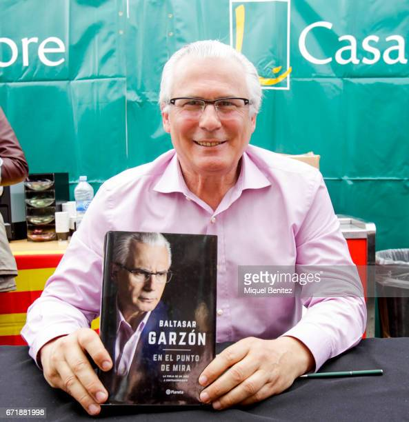 Baltasar Garzon signing his book during 'Sant Jordi's Day', 'Saint George's Day' at Passeig de Gracia boulevard on April 23, 2017 in Barcelona, Spain.