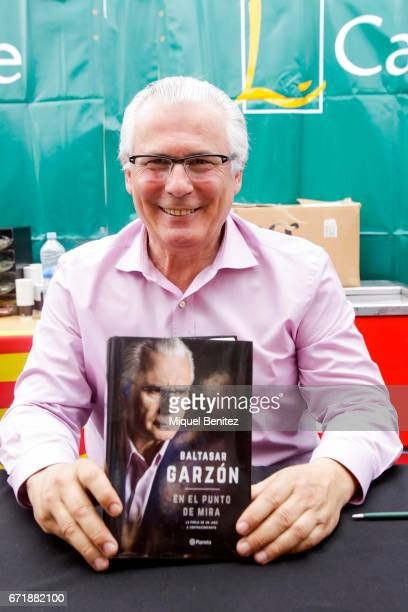 Baltasar Garzon signing his book during 'Sant Jordi's Day' 'Saint George's Day' at Passeig de Gracia boulevard on April 23 2017 in Barcelona Spain