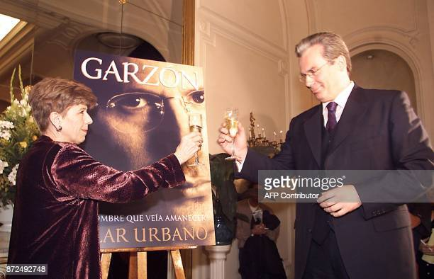 Baltasar Garzon the Spanish Judge who launched the legal pursuit of Chile's former dictator Augusto Pinochet toasts with Spanish journalist Pilar...