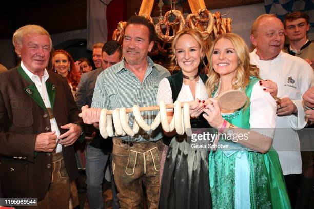 Balthasar Hauser Arnold Schwarzenegger Maria Hauser Heather Milligan during the 29th Weisswurstparty at Hotel Stanglwirt on January 24 2020 in Going...