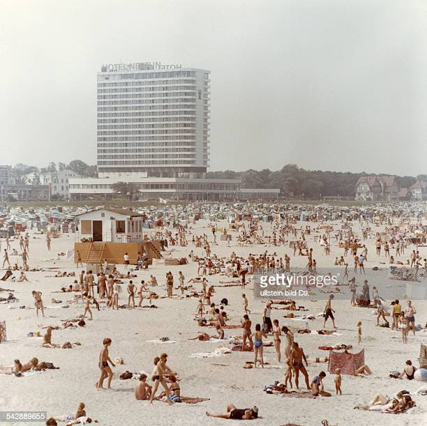 GDR Baltic sea beach at Warnemuende Hotel Neptun in the background 1981