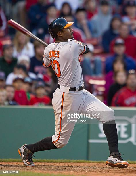 Baltimore Adam Jones watching the flight of his three run game winning home run off of Boston Red Sox outfielder Darnell MacDonld during the 17th...