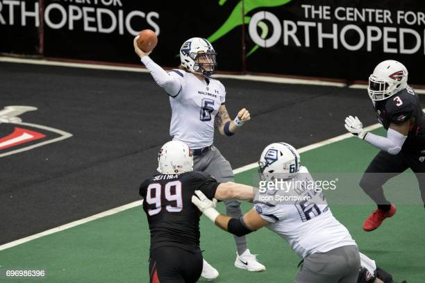 Baltimore Brigade QB Shane Carden throws a pass as Cleveland Gladiators DL Nick Seither and Cleveland Gladiators DL Darryl CatoBishop apply pressure...
