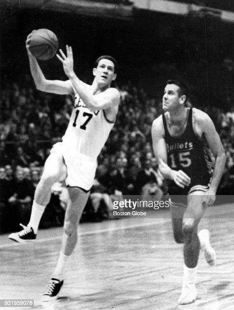 Baltimore Bullets Bailey Howell right runs after Boston Celtics John Havlicek left as he shoots during a game at the Boston Garden Oct 31 1965