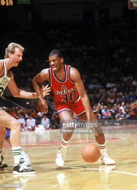 Baltimore Bullets Bernard King drives on Boston Celtics forward Larry Bird during a game in Hartford CT 1988