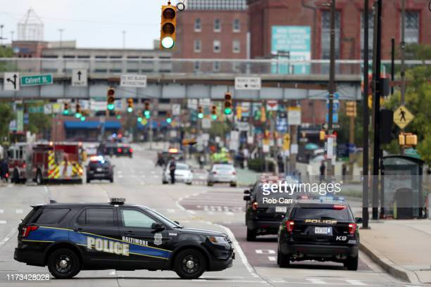Baltimore City police vehicles block off Pratt Street near the Transamerica Building as officials are investigating a suspicious van in a parking...