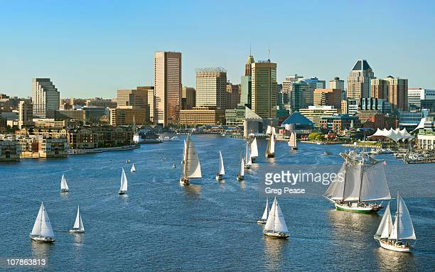 baltimore city skyline with the parade of sail - baltimore maryland - fotografias e filmes do acervo