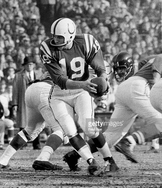 Baltimore Colts Hall of Fame quarterback Johnny Unitas prepares to hand off in a 3116 win over the New York Giants in a Championship game on December...