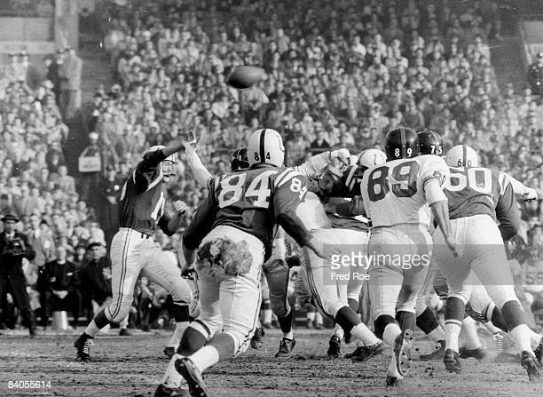 Baltimore Colts Hall of Fame quarterback Johnny Unitas throws a pass in a 3116 win over the New York Giants in a Championship game on December 27...