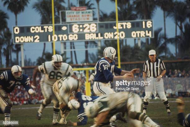 Baltimore Colts' Johnny Unitas looks for a receiver as the New York Jets close in for a tackle during Super Bowl III at the Orange Bowl on January 12...