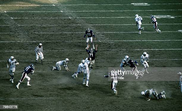 Baltimore Colts quarterback Bert Jones threads his pass past New York Giants defensive end Dave Gallagher during a 210 Colts victory on December 7 at...